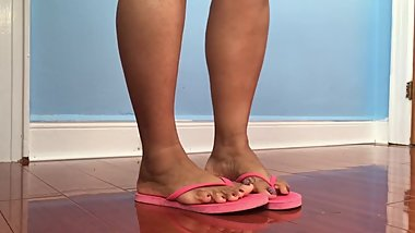 Indiangyal feet in pink flip flop