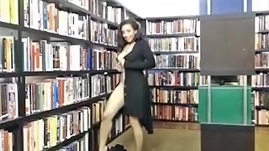 woman strips completely naked in library (no sound)