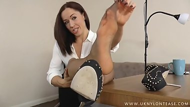 Kiki Devine Gets Caught with Her Nyloned Feet on the Office Desk
