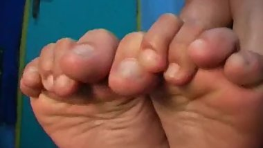 Asian Girl Wiggles Toes