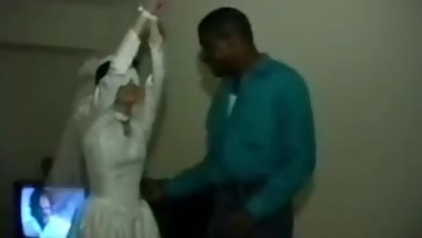 Blindfolded Bride bound in a gangbang