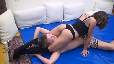 Mixed wrestling - Tall guy outmuscled by a short girl