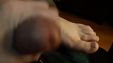 Jerking my cock quietly to her feet while she sleeps
