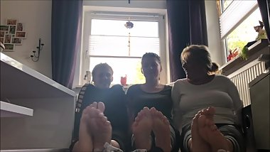 mother and daughters show off their socks and barefeet