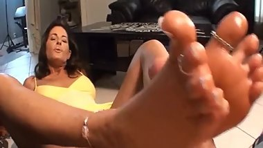 Girlfriend's Mom Gives a Foot Job