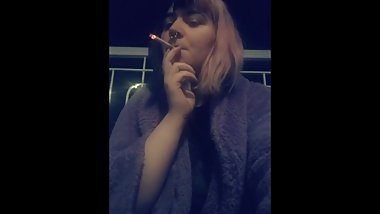 CUTE GIRL SMOKES A CIGARETTE