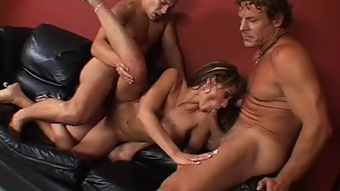 Big Tit Babe Takes Two Huge Cocks - Porn Throwback