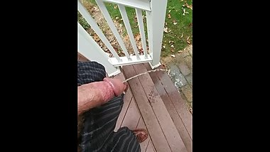 Over a minute of pissing off back steps in pajamas